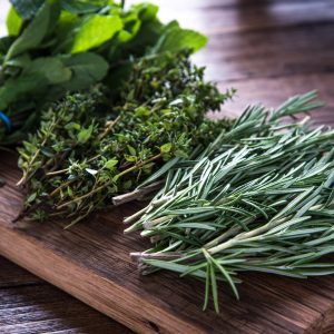 herbal supplements for dogs - fresh herbs on a wooden board
