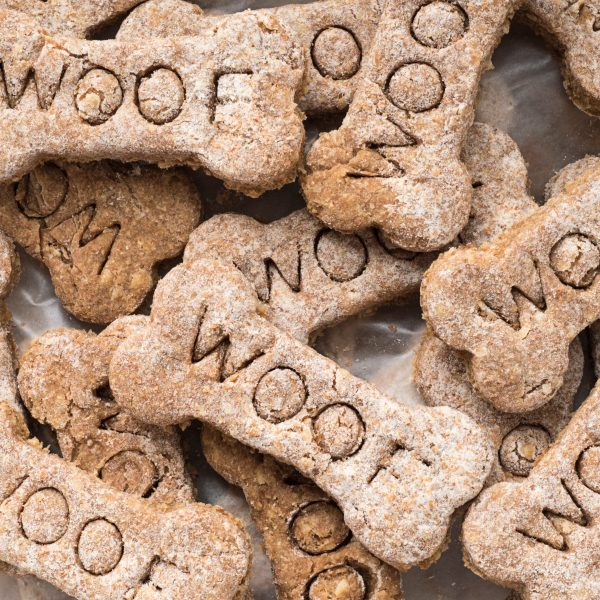 pile of dog treats with the word woof on them